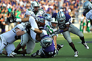 MANHATTAN, KS - AUGUST 30:  MANHATTAN, KS - August 30:  Running back Micah Mosley #32 of the North Texas Mean Green gets tackled by defenders Brandon Balkcom #92, Gary Chandler #21 and Antwon Moore #43 of the Kansas State Wildcats in the first quarter on August 30, 2008 at Bill Snyder Family Stadium in Manhattan, Kansas.
