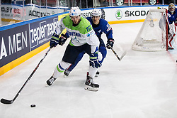 Nik Pem of Slovenia vs Kevin Hecquefeuille of France during the 2017 IIHF Men's World Championship group B Ice hockey match between National Teams of France and Slovenia, on May 15, 2017 in AccorHotels Arena in Paris, France. Photo by Vid Ponikvar / Sportida