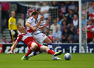 Loftus Road, London - Saturday 11th September 2010: Nicky Bailey (10) of Middlesborough tackles Jamie Mackie (12) of QPR during the Npower Championship match between Queens Park Rangers and Middlesborough. (Photo by Andrew Tobin/Focus Images)