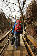 Mark Greeno, age 55, hikes to a climbing spot at Palisades State Park in Eastern South Dakota on March 26, 2010..