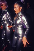 Two ravers dressed in silver jump suits at Ministry of Sound, Millenium Dome, New Years Eve, London, U.K, 2001.