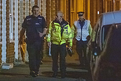 © Licensed to London News Pictures. 23/07/2020. Thame, UK. Police officers walk in the crime scene cordon on Chinnor Road. Thames Valley Police has launched a murder investigation in Thame. At approximately  19:05BST a man was found with injuries in Chinnor Road, Thame. The 20-year-old man was pronounced dead at the scene. Photo credit: Peter Manning/LNP