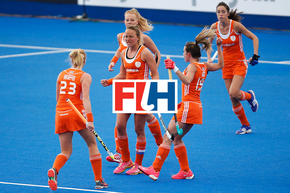 LONDON, ENGLAND - JUNE 18:  Maartje Paumen (centre) of the Netherlands celebrates scoring her teams opening goal during the FIH Women's Hockey Champions Trophy 2016 match between Netherlands and New Zealand at Queen Elizabeth Olympic Park on June 18, 2016 in London, England.  (Photo by Joel Ford/Getty Images)