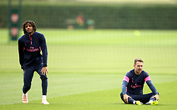 Arsenal's Mohamed Elneny (left) and Aaron Ramsey during the training session at London Colney, Hertfordshire.