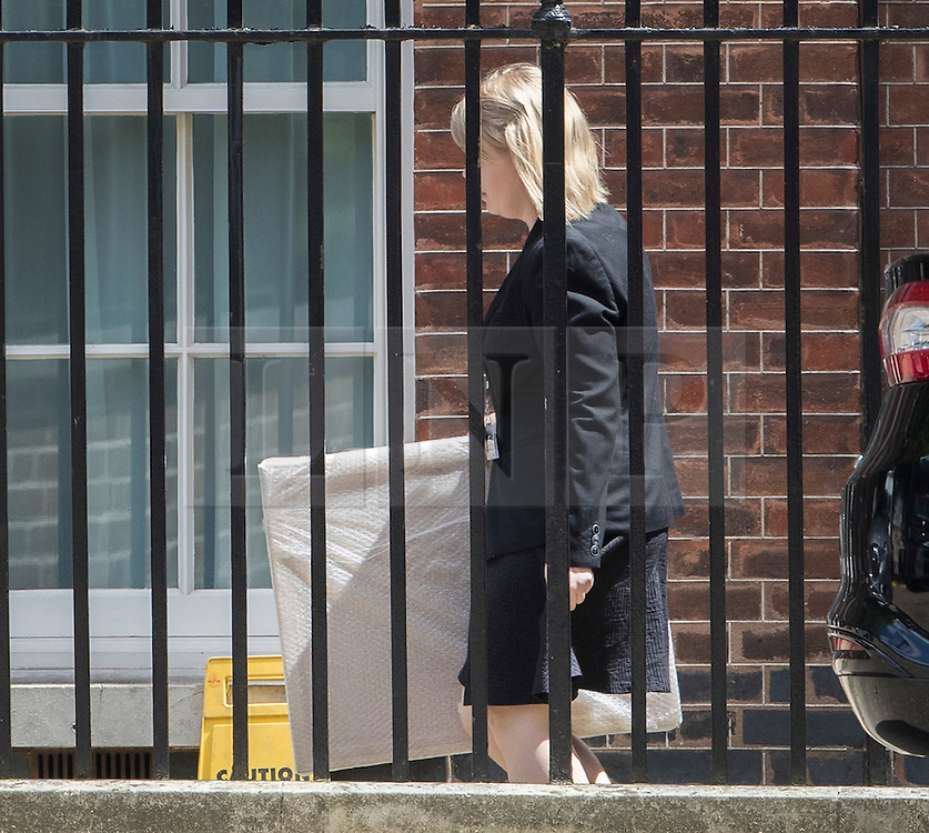 © Licensed to London News Pictures. 14/07/2016. London, UK. A bubble wrapped painting arrives at the back door of Downing Street as Prime Minister Theresa May continues to make cabinet appointments on her first full day in office. Photo credit: Peter Macdiarmid/LNP