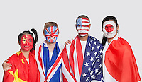 Portrait of multi-ethnic group with national flags and face painting against white background