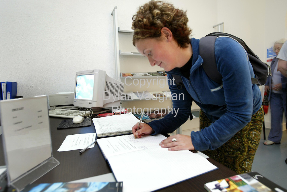"14/8/2002 .Video Artist Gail O Reilly pictured signing the book at the enterence to the Paul McCarthy show at the Butler Gallery in Kilkenny yesterday. The book had to be signed before entry after a direction from the censors board after the exhibition was closed after a complaint. Gail who will be part of the next exhibition at the gallery ""The Victor Treacy award"" may have her work censored by the Censor board after yesterdays closure..Picture Dylan Vaughan"