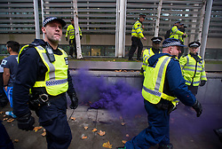 © Licensed to London News Pictures. 04/11/2015. London, UK.   Demonstrators clash with police as Thousands of students take part in a demonstration in central London against tuition fees. The rally which starts outside the University of London Union, will feature a speech from Shadow Chancellor John McDonnell.  Photo credit: Ben Cawthra/LNP