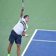 MILOS RAONIC hits a serve during his second round match at the Citi Open at the Rock Creek Park Tennis Center in Washington, D.C.