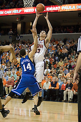 Virginia's Jason Cain (33) shoots over Duke's David McClure (14).  The University of Virginia Cavaliers beat the #8 ranked Duke University Blue Devils 68-66 in overtime at the John Paul Jones Arena in Charlottesville, VA on February 1, 2007...