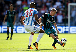 Steven Davis of Southampton and Mathias Zanka Jorgensen of Huddersfield Town - Mandatory by-line: Matt McNulty/JMP - 26/08/2017 - FOOTBALL - The John Smith's Stadium - Huddersfield, England - Huddersfield Town v Southampton - Premier League