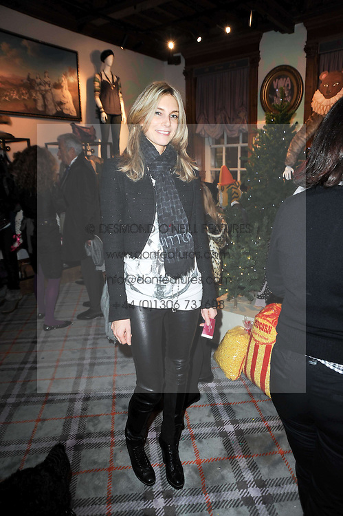 KIM HERSOV at the Juicy Couture children's tea party in aid of Mothers 4 Children held at the Juicy Couture Store, Bruton Street, London on2nd December 2009.