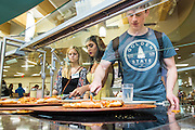 Zach Hualey, from Dublin, selects a slice of pizza in Nelson Commons during Bobcat Student Orientation on Thursday, June 4, 2015.  Photo by Ohio University  /  Rob Hardin