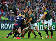 USA Oli Kilifi getting tackled during the Rugby World Cup Pool B match between South Africa and USA at the Queen Elizabeth II Olympic Park, London, United Kingdom on 7 October 2015. Photo by Matthew Redman.