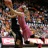 Oregon State's Sydney Wiese, front, is fouled by Colorado's Jamee Swan, rear, while driving to the basket in the second half of an NCAA college basketball game in Corvallis, Ore., on Friday, Feb. 12, 2016. Oregon State won 73-50. (AP Photo/Timothy J. Gonzalez)
