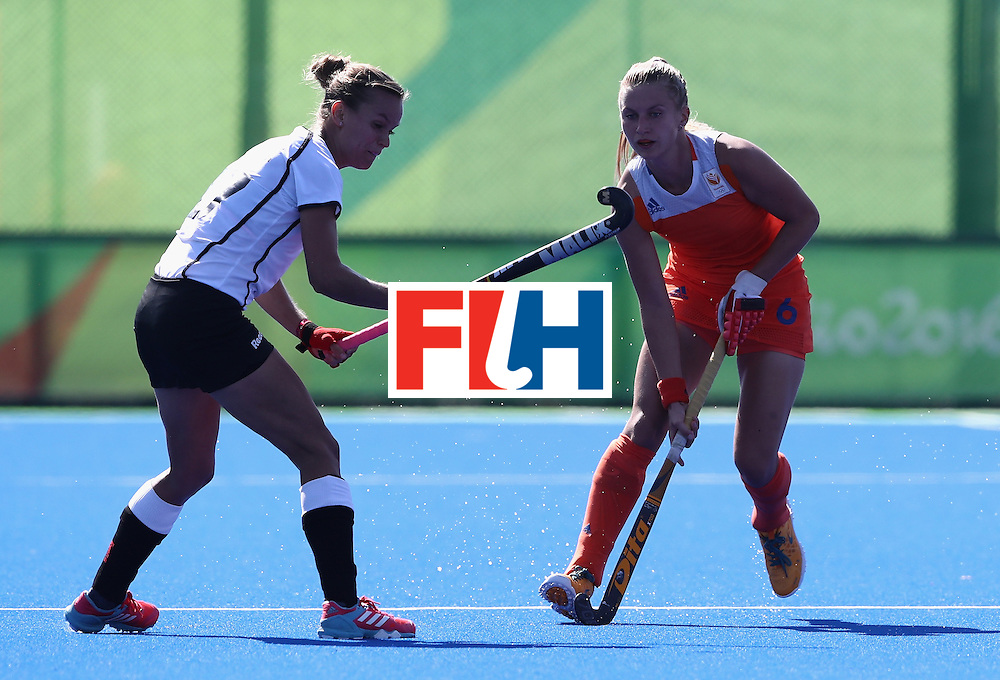 RIO DE JANEIRO, BRAZIL - AUGUST 13:  Laurien Leurink of the Netherlands is tackled by Jana Teschke (L) during the Women's group A hockey match between the Netherlands and Germany on Day 8 of the Rio 2016 Olympic Games at the Olympic Hockey Centre on August 13, 2016 in Rio de Janeiro, Brazil.  (Photo by David Rogers/Getty Images)