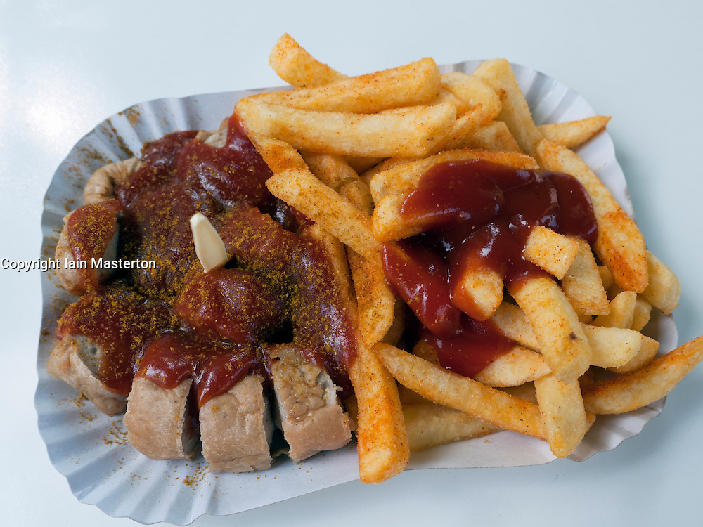 Detail of traditional Berlin currywurst snack at famous Konnopke`s currywurst stall in Prenzlauer Berg in Berlin Germany