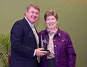 ACC Commissioner John D. Swofford presents former Clemson coach Annie Tribble with her Women's ACC Legends Award at the 2011 ACC Legends Banquette held at the Terrace Greensboro Coliseum Complex  in Greensboro, North Carolina.  (Photo by Mark W. Sutton)