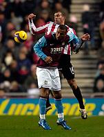 Photo: Jed Wee/Sportsbeat Images.<br /> Sunderland v Aston Villa. The FA Barclays Premiership. 15/12/2007.<br /> <br /> Sunderland's Danny Higginbotham (R) jumps to deny Aston Villa's Gabriel Agbonlahor.