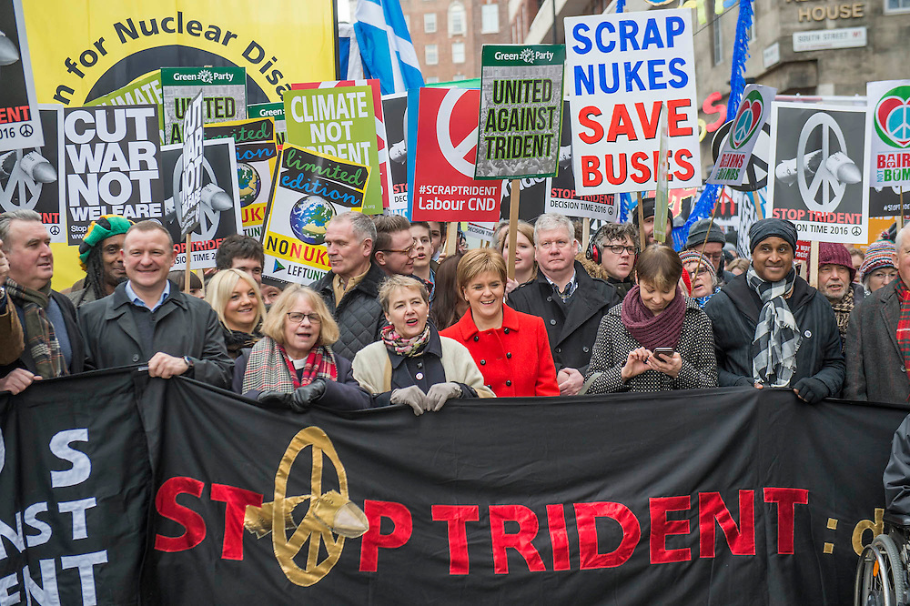 """Nicola Sturgeon - A CND led national demonstration to protest against Britain's nuclear weapons system: Trident. They state - """"The majority of the British people, including the Labour leader Jeremy Corbyn, oppose nuclear weapons. They are weapons of mass destruction, they don't keep us safe and they divert resources from essential spending."""" The march from Hyde park to Trafalgar Square was supported by Friends of the Earth, the Green party, Greenpeace, the PCS Union, the Quakers, the Stop the War Coalition, War on Want amongst amny others."""