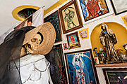 A shrine and offerings inside the La Casa De La Santa Muerte or House of the Saint of the Dead November 1, 2017 in Santa Ana Chapitiro, Michoacan, Mexico.