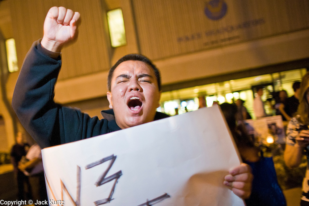 11 OCTOBER 2010 - PHOENIX, AZ:  JAVIER CORONA, from Phoenix, pickets Phoenix police headquarters Monday night. About 300 people gathered at the Phoenix Police Department headquarters building Monday night to protest the shooting of Daniel Rodriguez and his dog. The officers responded to a 911 call made by Rodriguez' mother. A scuffle ensued when they arrived and Phoenix police officer Richard Chrisman shot Rodriguez, who was unarmed, and his dog. Chrisman then allegedly filed a false report about the event. He has been arrested on felony assault charges. The event has angered some in the Latino community and they have held a series of protests at the police headquarters. They want Chrisman charged with murder.    Photo by Jack Kurtz