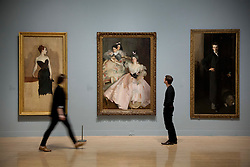 © Licensed to London News Pictures. 30/01/2012. London, UK. Gallery staff look at John Singer Sargent's 'Mrs Carl Meyer and her Children' (Centre) as it hangs with 'Study of Mme Gautreau' (Left),  and 'W. Graham Robertson' (Right)  at a new Tate Exhibition entitled Migrations: Journeys into British Art. The Exhibition explores how British art has been influenced by migration and includes work by van Dyck, Whistler, Mondrian and Steve McQueen. Photo credit: Matt Cetti-Roberts/LNP