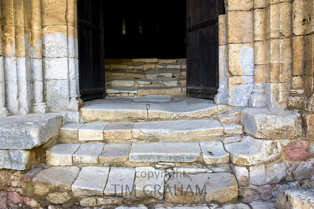 Old stone steps in the ancient church at St Amand de Coly in the Dordogne, France