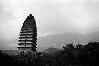China, Dengfeng, 2007. An ancient pagoda leans slightly toward Song Shan, a jagged mountain chain in Henan dotted with Buddhist temples and myriad small Taoist shrines..