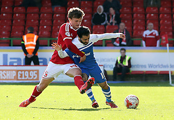 Peterborough United's Erhun Oztumer battles with Swindon Town's John Swift - Photo mandatory by-line: Joe Dent/JMP - Mobile: 07966 386802 - 11/04/2015 - SPORT - Football - Swindon - County Ground - Swindon Town v Peterborough United - Sky Bet League One