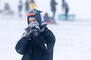 UNITED KINGDOM, London: 01 March 2018 A boy enjoying the snow wraps up warm on Hampstead Heath this morning. The cold weather and snow is set continue as Storm Emma makes it's way across the country. Rick Findler / Story Picture Agency