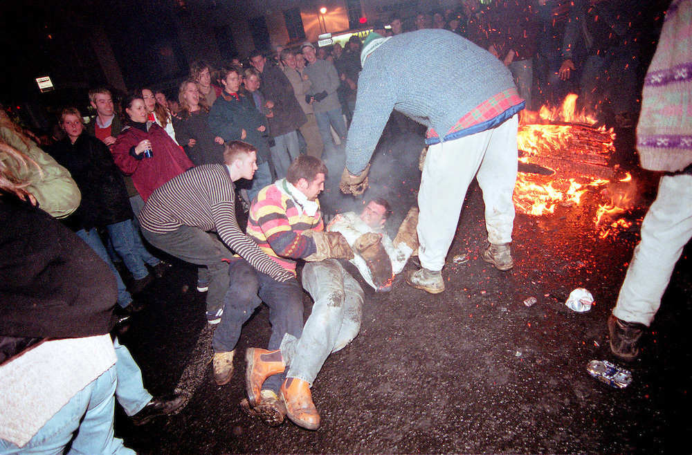 """BARREL MAN FALLS OVER"".TAR BARRELS OF OTTERY ST MARY EAST DEVON..BY RUPERT RIVETT©2003..07771928201 .(01273)695107"
