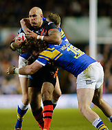 Anthony Mullally and Brad Singleton of Leeds Rhinos tackle Jake Webster of Castleford Tigers during the Betfred Super League match at Elland Road, Leeds<br /> Picture by Stephen Gaunt/Focus Images Ltd +447904 833202<br /> 23/03/2018
