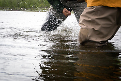 4 July 2017, Tjuonajokk, Lapland, Sweden: Tjuonajokk is an old Sami village by the River Kaitum in northern Sweden, now used as a fishing lodge for flyfishers from across the world. The camp is part of Fishyourdream. Here, Marc from Australia fights a Pike.