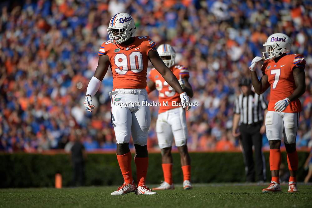 Florida defensive lineman Antonneous Clayton (90) lines up for a play during the second half of an NCAA college football game against Florida State Saturday, Nov. 25, 2017, in Gainesville, Fla. FSU won 38-22. (Photo by Phelan M. Ebenhack)