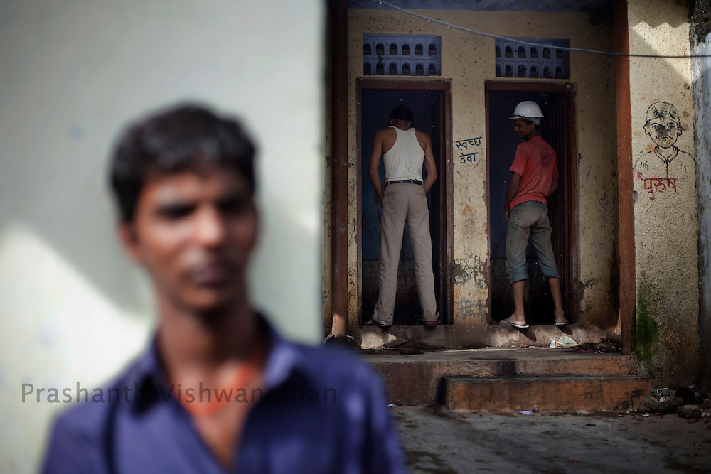 Construction labourers use the public urinal on a street in Dharavi , in Mumbai, India, Saturday, July, 18, 2009. Photographer: Prashanth Vishwanathan/Bloomberg