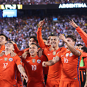 EAST RUTHERFORD, NEW JERSEY - JUNE 26: Gary Medel #17 of Chile, Fabian Orellana #19 of Chile, Francisco Silva #5 of Chile, Nicolas Castillo #16 of Chile and Mauricio Pinilla #9 of Chile and other team members celebrate victory after their penalty shoot out win during the Argentina Vs Chile Final match of the Copa America Centenario USA 2016 Tournament at MetLife Stadium on June 26, 2016 in East Rutherford, New Jersey. (Photo by Tim Clayton/Corbis via Getty Images)