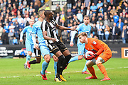 Coventry City goalkeeper Lee Burge (1) saves a chance from Notts County forward Shola Ameobi (9)  during the EFL Sky Bet League 2 match between Notts County and Coventry City at Meadow Lane, Nottingham, England on 7 April 2018. Picture by Jon Hobley.