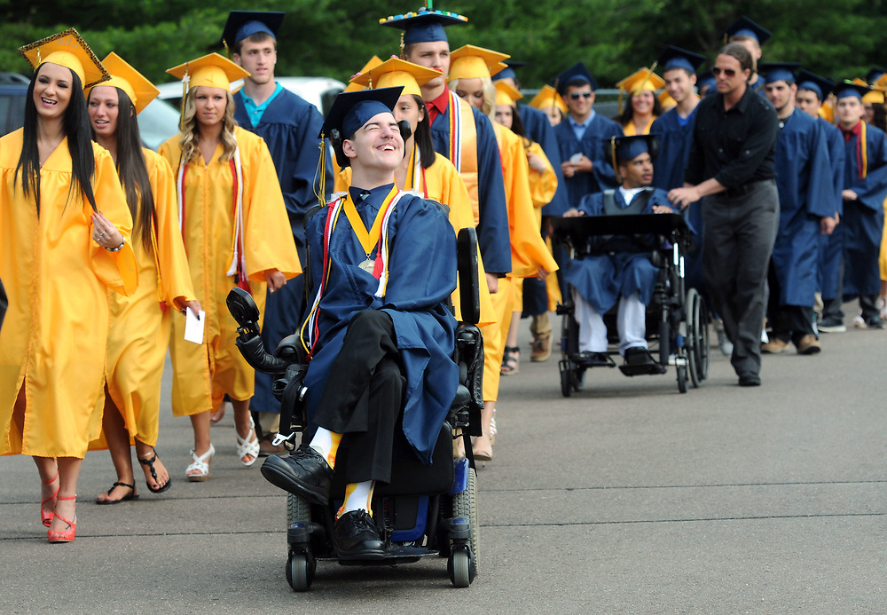 (Mara Lavitt — New Haven Register) <br /> June 23, 2014 East Haven<br /> East Haven High School Class of 2014 graduation ceremony. Valedictorian Michael Scoopo happily led the procession onto the field.<br /> mlavitt@newhavenregister.com