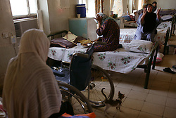 Women are seen resting after lunch at a retirement home in Sadr City, Baghdad, Iraq, July 22, 2003. Even though most families in Iraq care for their aging relatives at home, there is still a need for the facility, which is the largest of its kind in Baghdad housing 45 women and 87 men. The facility was not looted during the war, but it is still lacks some funding and is in need of medications for patients with chronic conditions such as heart disease and diabetes.