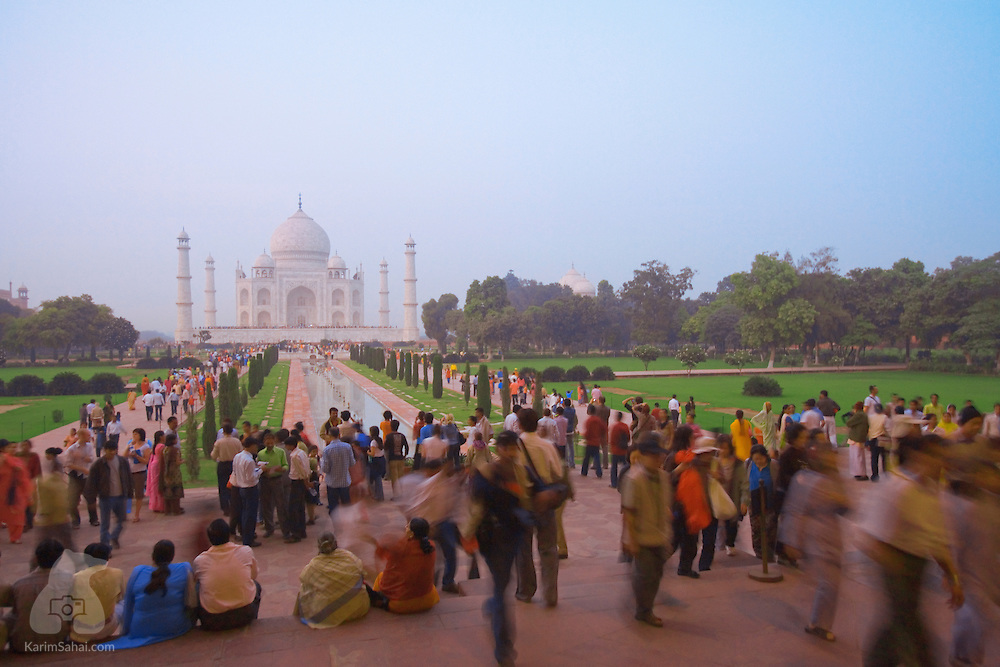 Tourists visiting the Taj Mahal at dusk, Agra, Uttar Pradesh, India.