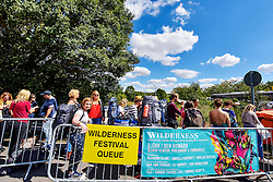 © Licensed to London News Pictures. 07/08/2015. Cornbury Park, Charlbury, Oxfordshire. Wilderness Festival 2015 at Cornbury Park in Oxfordshire attracted crowds of 30,000. Many chose to travel by train and FGW put on extra trains which were full with standing room only. The trains arrived from London at Charlbury station. Photo credit : MARK HEMSWORTH/LNP