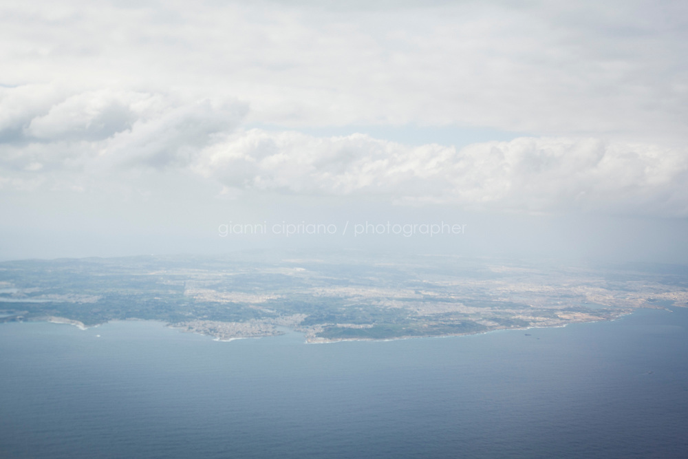 25 February 2011, Malta International Airport. The island of Malta as seen from an airplane. A ferry sent by the U.S. that will bring American citizens out of Libya is finally on its way to Malta, leaving just after 6:30 a.m. EST Friday morning.  According to the State Department there are 285 passengers on board the Dolores, including 167 U.S. citizens and 118 people of other nationalities. For two days, rough weather in the Mediterranean Sea, with waves up to 16 feet high, had made it impossible for the ferry to leave. Thousands of foreigners have fled Colonel Gaddafi's regime as his forces continue to clash with anti-government demonstrators.<br /> &copy;2011 Gianni Cipriano<br /> cell. +1 646 465 2168 (USA)<br /> cell. +39 328 567 7923<br /> gianni@giannicipriano.com<br /> www.giannicipriano.com