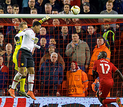 LIVERPOOL, ENGLAND - Thursday, March 10, 2016: Liverpool's goalkeeper Simon Mignolet punches the ball away against Manchester United during the UEFA Europa League Round of 16 1st Leg match at Anfield. (Pic by David Rawcliffe/Propaganda)