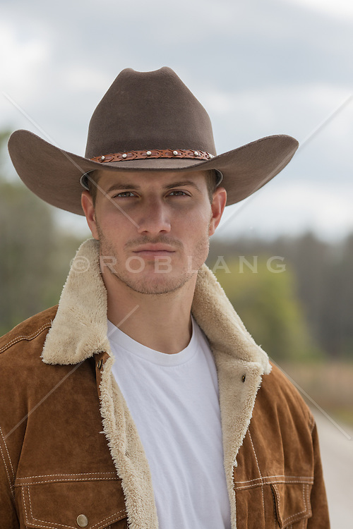 portrait of a rugged cowboy outdoors