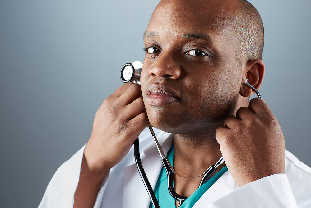 A portrait series representing the intense emotions that Doctors face.  An African American male Doctor wearing a white lab coat, stethoscope, and green medical scrub suit shown.