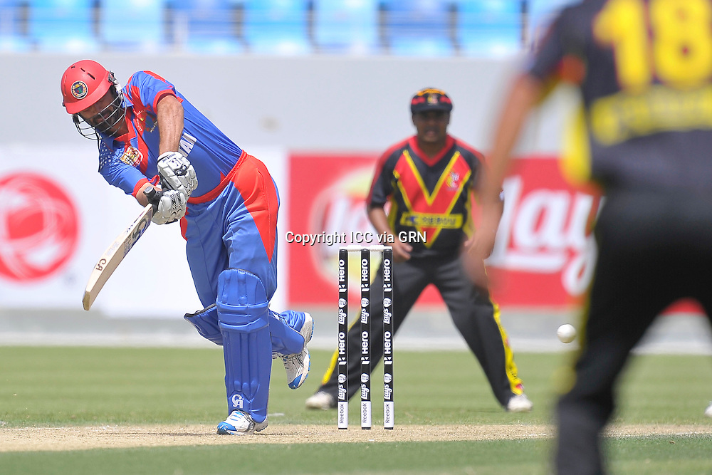 Afghanistan's pair of Captain Nawroz Mangal  during thier opening match at the T20 World Cup Quaifiers at the Dubai Internatioal Stadium. Pix International Cricket Council/Thusith Wijedoru