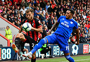 Ryan Fraser (24) of AFC Bournemouth battles for possession with Nathaniel Mendez-Laing (19) of Cardiff City during the Premier League match between Bournemouth and Cardiff City at the Vitality Stadium, Bournemouth, England on 11 August 2018.