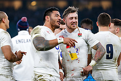 Manu Tuilagi and  Jack Nowell share a joke after England hang on to win the match 25-21 to lift the Triple Crown having beaten Scotland, Ireland and Wales in the 6 Nations - Mandatory byline: Rogan Thomson/JMP - 12/03/2016 - RUGBY UNION - Twickenham Stadium - London, England - England v Wales - RBS 6 Nations 2016.