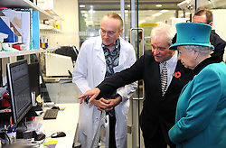 Senior scientist Aengus Stewart (left) and Sir Paul Nurse show Queen Elizabeth II, a genome data display during her visit to officially open the Francis Crick Institute in central London.